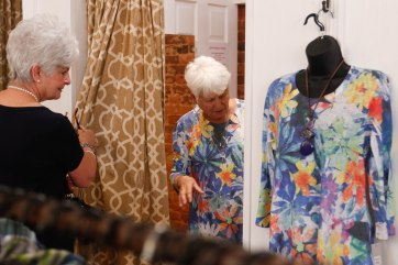 Margaret Merchant, 68, manager of Maggie Lane, from Waycross, Georgia, helps Lucy Fambrough, 82, retired, from Watkinsville, Georgia, pick out an outfit on Friday, March, 23, 2018, in Maggie Lane in Greensboro, Georgia. The outfit happens to be the same one that is on the mannequin outside of her dressing room. (Photo/Marlee A. Middlebrooks, mam94237@uga.edu)