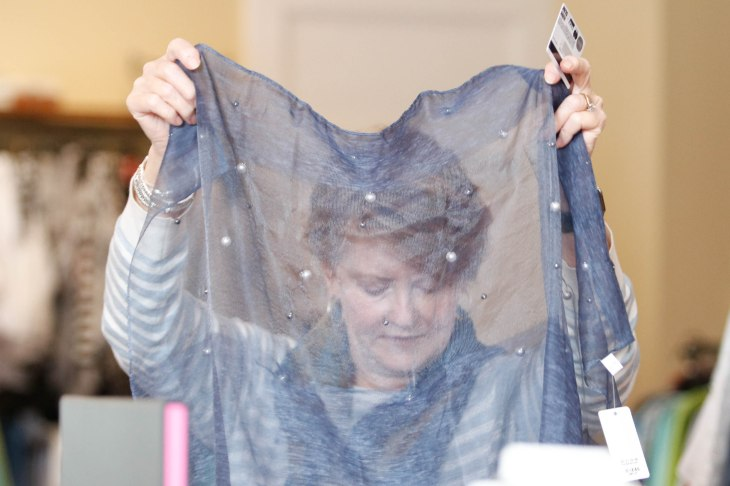 Linda Edmiston, 65, nurse anesthetist, from Greensboro, Georgia, looks at a scarf in Maggie Lane on Saturday, March 24, 2018, in Greensboro, Georgia. She was just in the store the day before, and she returned the next day. (Photo/Marlee A. Middlebrooks, mam94237@uga.edu)