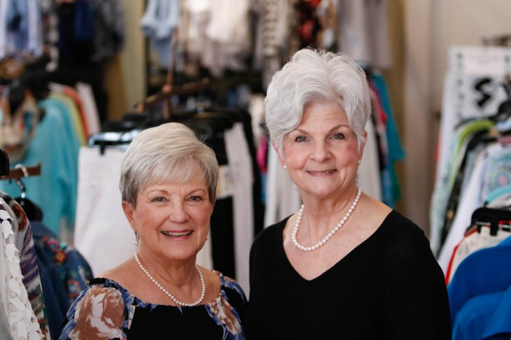 Elaine Vickery (left), 73, assistant manager of Maggie Lane, from Commerce, Georgia, and Margaret Merchant (right), 68, manager of Maggie Lane, from Waycross, Georgia, pose for a portrait in Maggie Lane in Downtown Greensboro, Georgia, on Saturday, March 24, 2018, in Greene County, Georgia. Merchant has been the manager of this location for three years; previously, she worked in education for 35 years before retiring. Vickery has worked for Maggie Lane for one and a half years; previously, she worked in management before retiring. (Photo/Marlee A. Middlebrooks, mam94237@uga.edu)