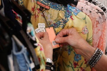Margaret Merchant, 68, manager of Maggie Lane, from Waycross, Georgia, tags an article of clothing on Saturday, March 24, 2018, in Greensboro, Georgia. Merchant has been the manager of this location for three years, and some of her jobs include tagging clothes, steaming clothes and deciding where to arrange the merchandise around the store. (Photo/Marlee A. Middlebrooks, mam94237@uga.edu)